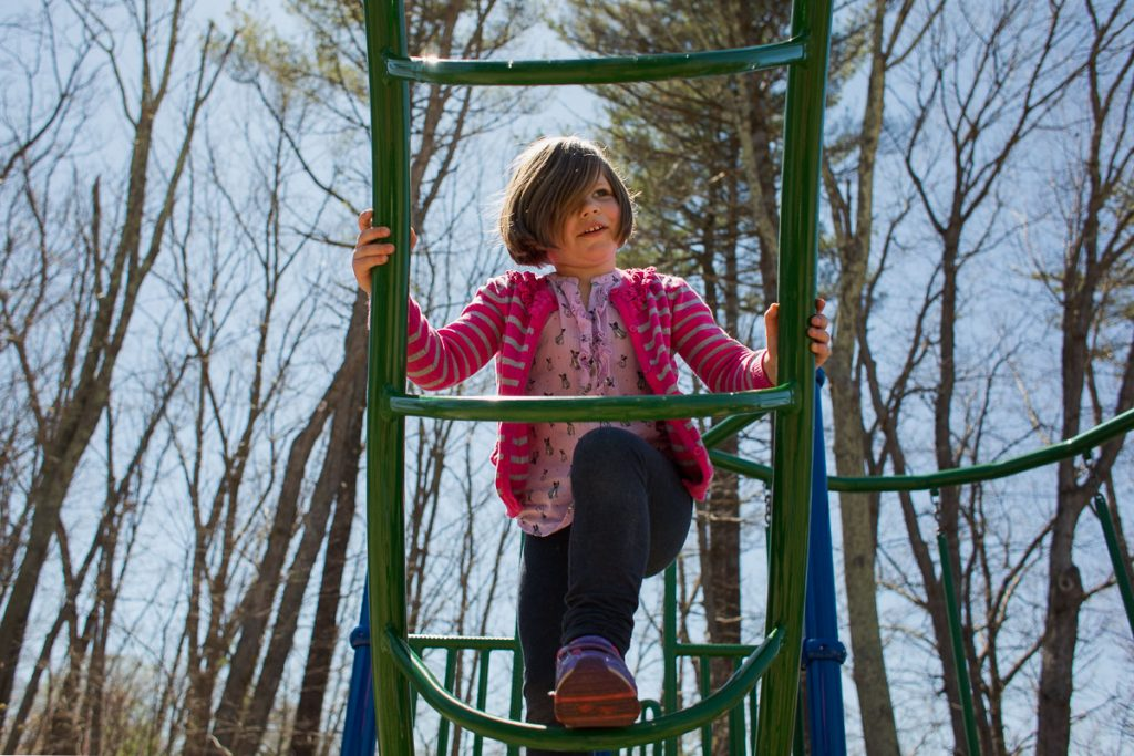 A girl climbing at the playground